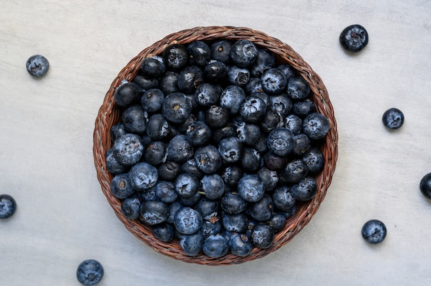 Fresh blueberries in a rustic bowl