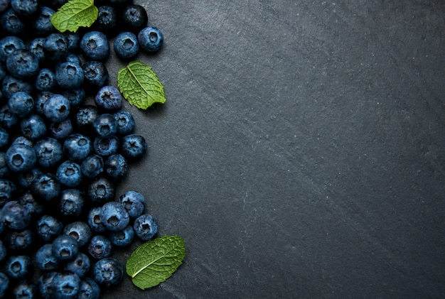 Fresh blueberries on a stone background