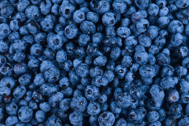 新鮮なブルーベリーの背景。テクスチャのブルーベリーの果実をクローズアップ。