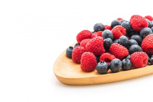 Fresh blueberry and rasberry on white