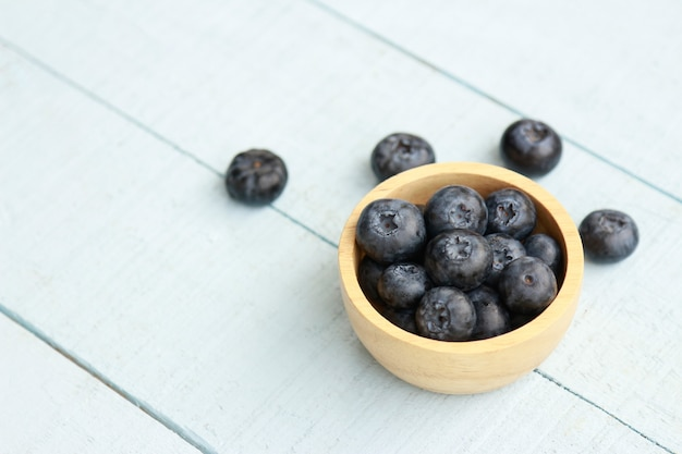 Fresh blueberry in wooden bowl for healthy eating
