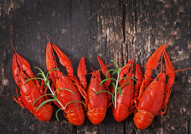 Fresh boiled crawfish on the old wooden surface