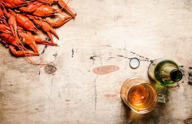 Fresh boiled crawfish with beer. on wooden table.