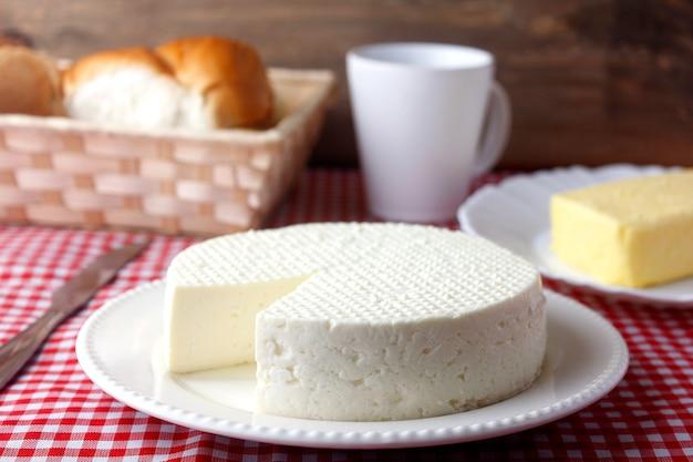 Fresh brazilian white minas cheese on a plate