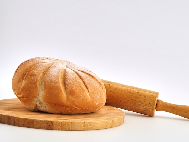 Fresh bread isolated on wooden board white background