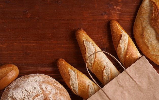 Fresh bread in a paper bag. small bakery concept with gluten free flavored bread