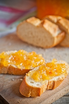 Fresh bread with orange jam