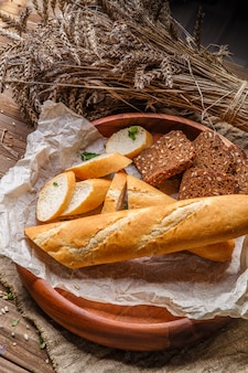Fresh bread in wooden dish