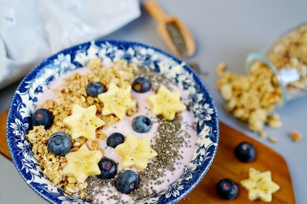 Fresh breakfast yogurt with muesli banana berries granola