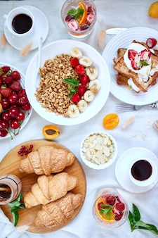 Fresh and bright continental breakfast table. top view