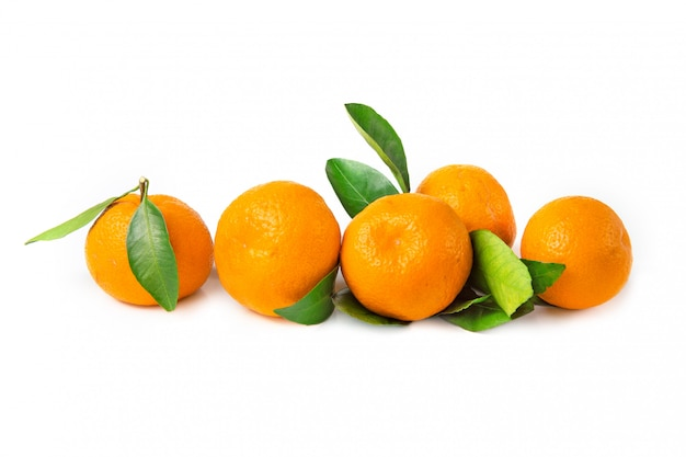 Fresh, bright fruits. tangerines with leaf on a white isolated background.
