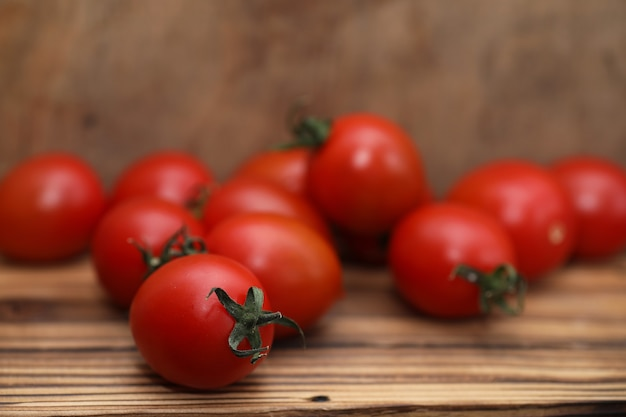 Fresh bright and juicy tomatoes on the kitchen table