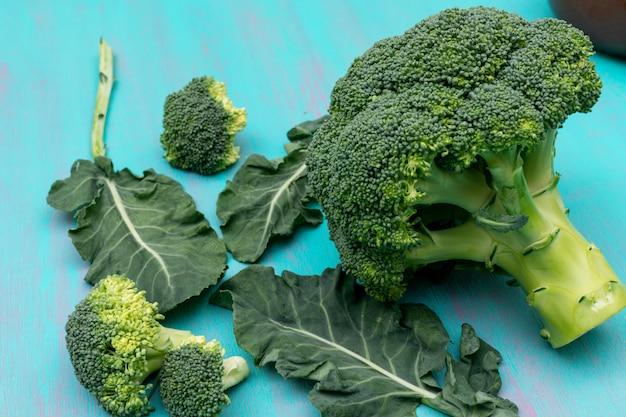 Fresh broccoli on blue surface
