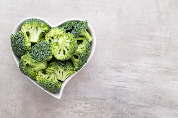 Fresh broccoli in a heart shaped bowl