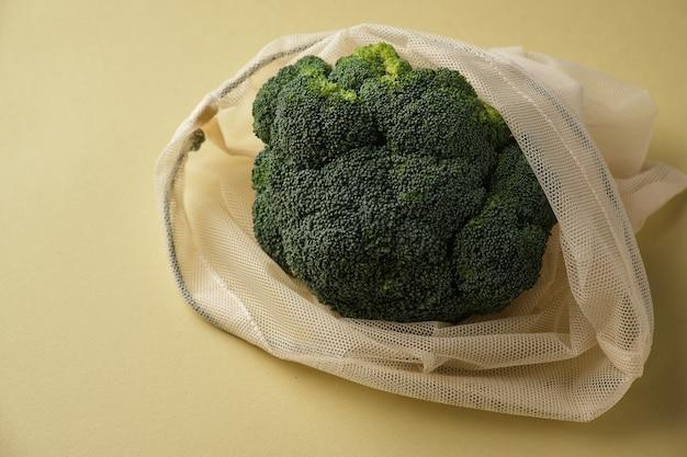 Fresh broccoli in a reusable fabric eco bag reusable ecofriendly products
