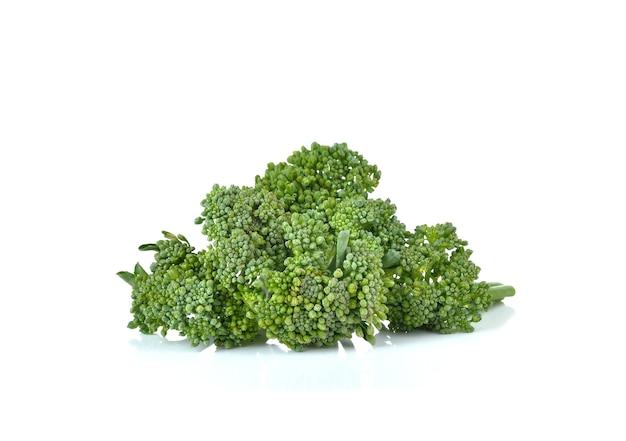 Fresh broccoli on white wall