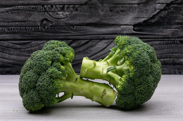 Fresh broccoli on white wood table