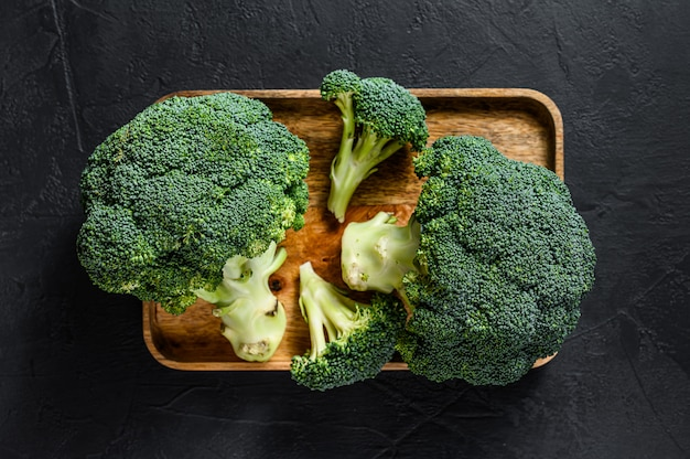 Fresh broccoli in a wooden bowl.