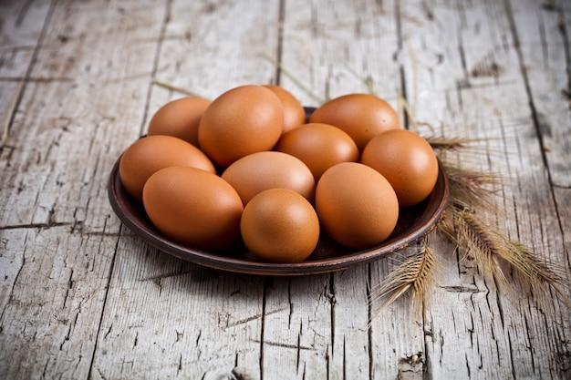 Fresh brown eggs in plate