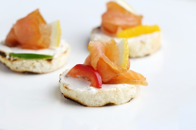 Fresh bruschetta appetizers isolated on a white surface