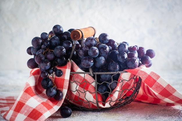 Fresh bunch of grapes in a metal basket