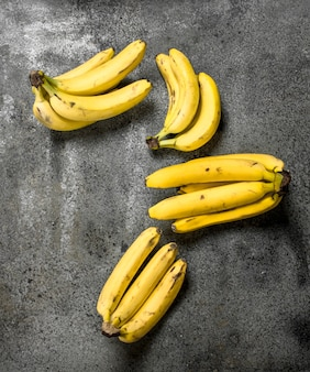 Fresh bunches of bananas. on a rustic background.