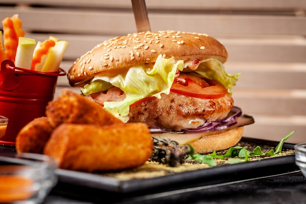 Fresh burger made from soy patties, with vegetables and salad, with potato crunch and fresh vegetables.