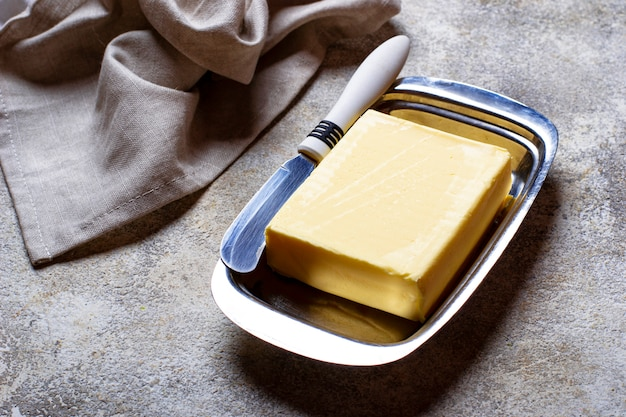 Fresh butter and knife in butter-dish