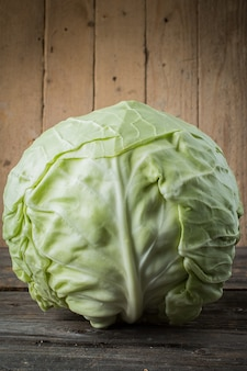 Fresh cabbage on rustic table