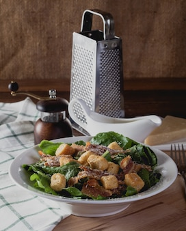Fresh caesar salad on a wooden table