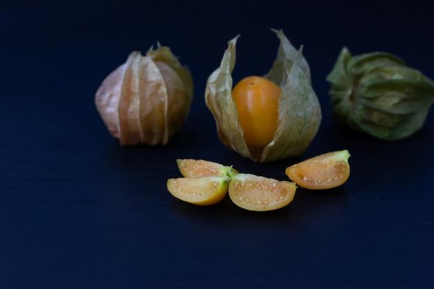 Fresh cape gooseberry  fruit isolate on wood