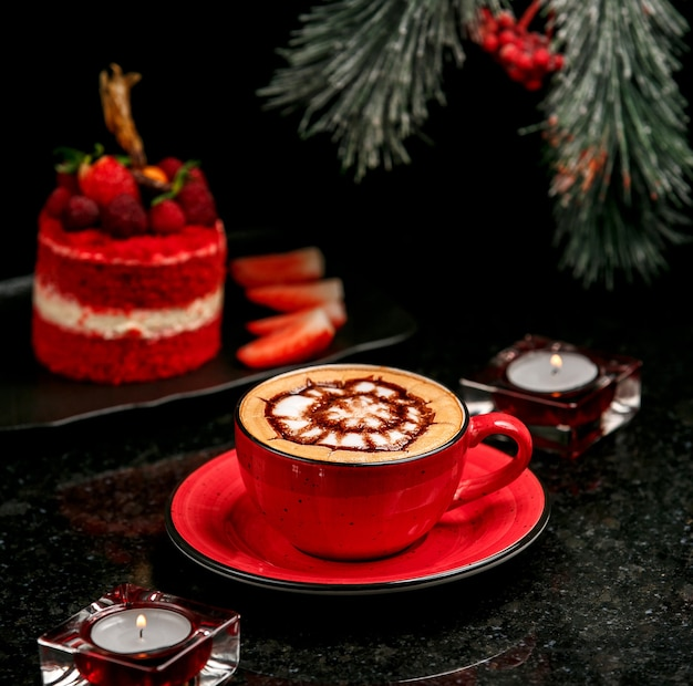 Fresh cappuccino in red cup