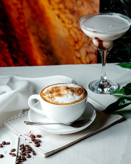 Fresh cappuccino on the table