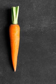 Fresh carrot on the black backgound