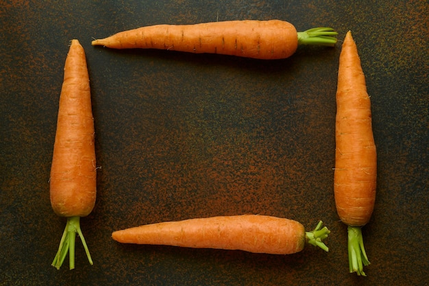 Fresh carrot frame with copy space