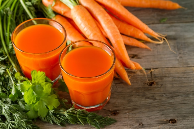 Fresh carrot smoothie in two glasses