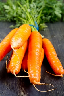Fresh carrots isolated on woodbackground