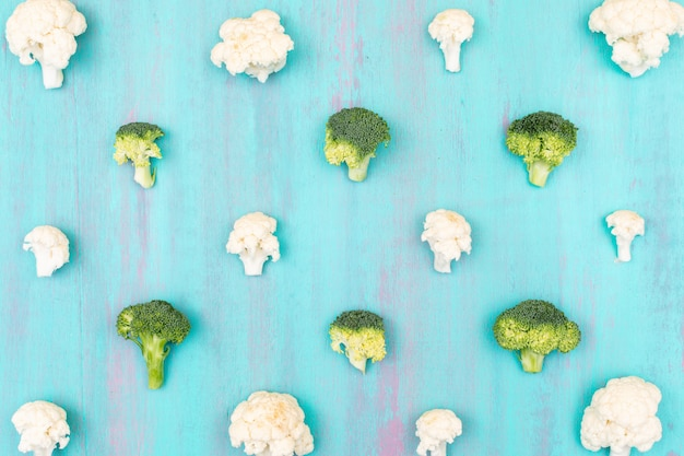 Fresh cauliflower and broccoli pattern on the blue surface