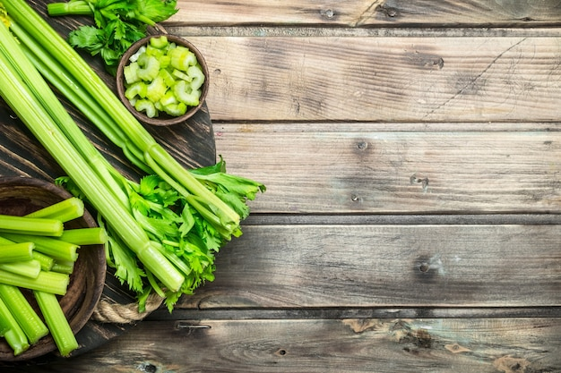 Fresh celery on a tray. on wooden table