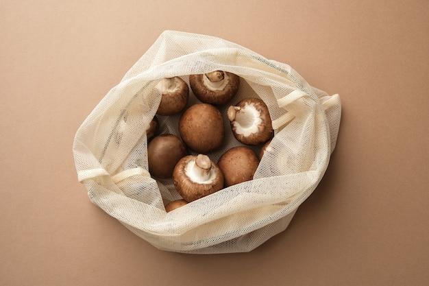 Fresh champignon in a reusable fabric eco bag reusable ecofriendly products