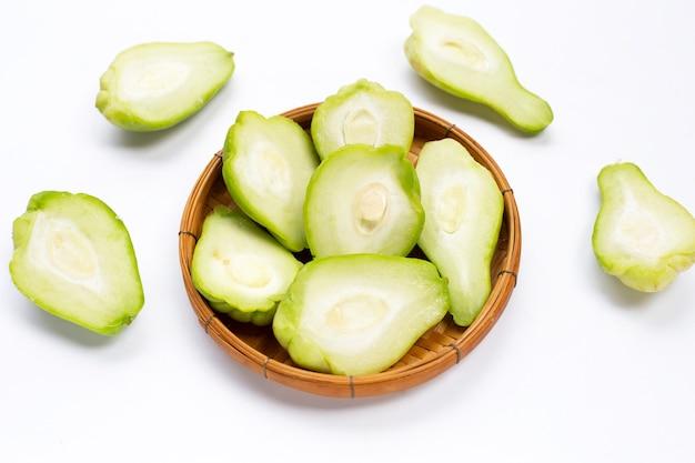 Fresh chayote fruit on white background.