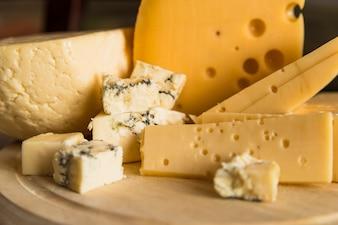 Fresh cheese on wood chopping board