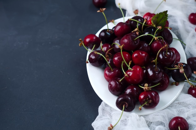 Fresh cherries in plate