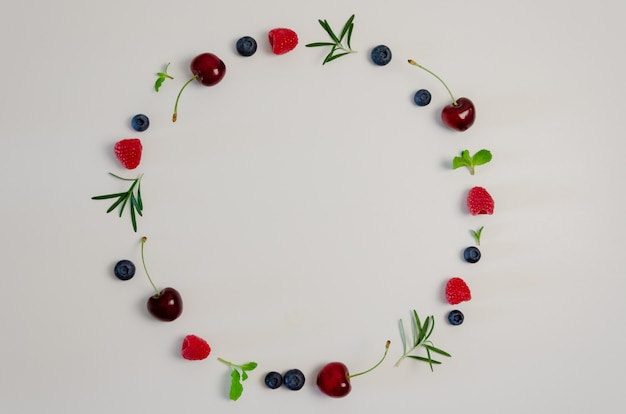 Fresh cherry, blueberry, raspberry, mint and rosemary leaf