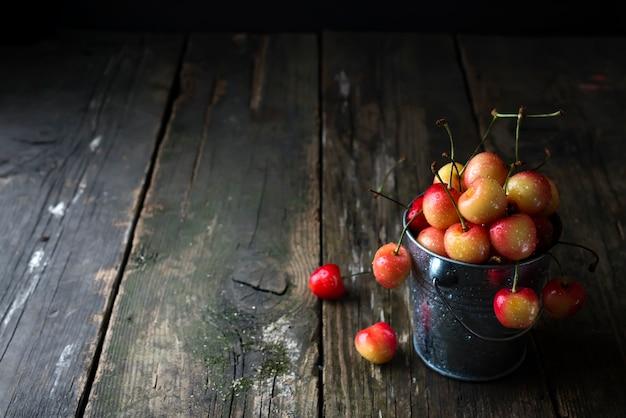 Fresh cherry in a bucket