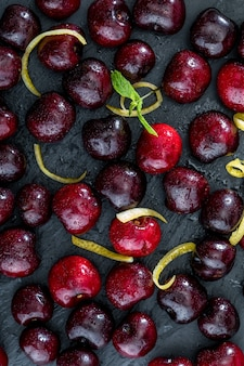 Fresh cherry pints on black background