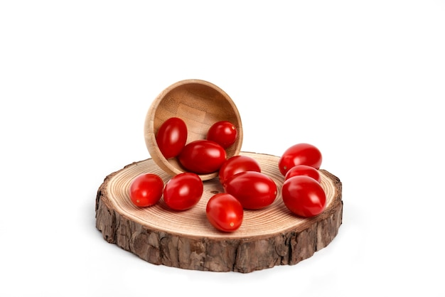 Fresh cherry tomatoes in a wooden bowl