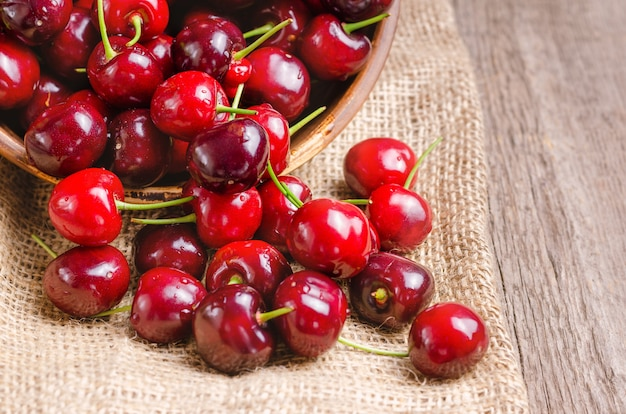 Fresh cherry on wooden table.