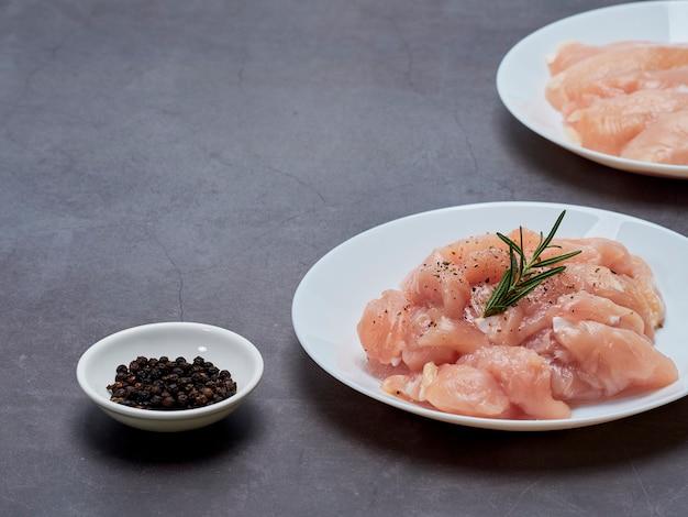 Fresh chicken tenderloin on stone table top