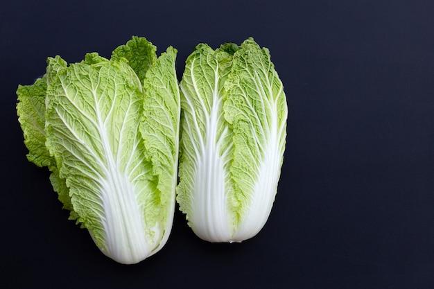 Fresh chinese cabbage on dark surface